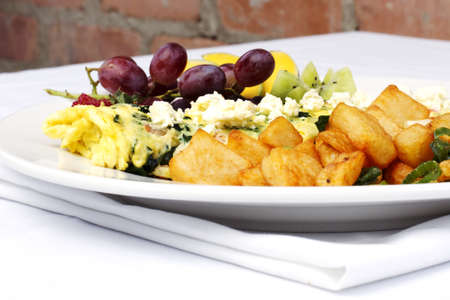 browns: Greek style omelette with assorted fruits and hash browns