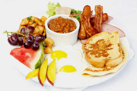 Full breakfast with eggs bacon beans french toast crepes Stock Photo
