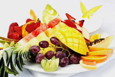 Platter of a assorted fresh fruit cut professionally photo