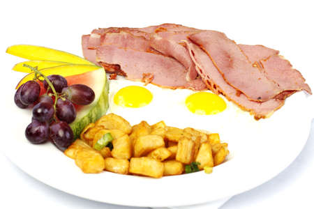 hashbrown: Pastrami and eggs with fruit on white plate