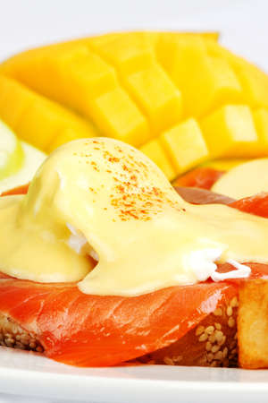 hashbrowns: Smoked salmon eggs benedict with fresh fruit on the side