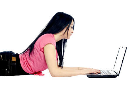 lap top: Young woman laying on stomach with lap top against white background