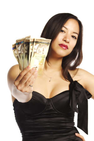 Closeup of a pretty female in black dress displaying Canadian currency - Isolated photo