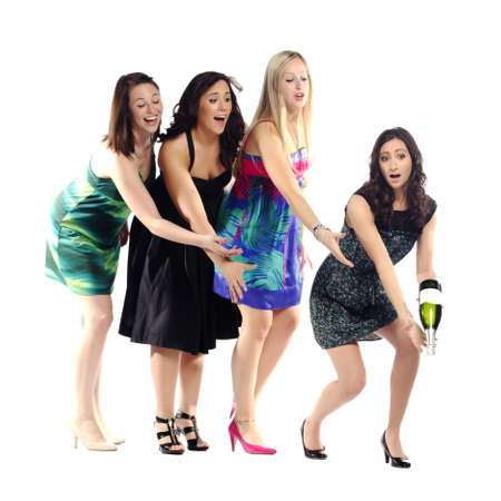 notorious: Notorious group of girls trying to save a bottle of champagne isolated on white background Stock Photo