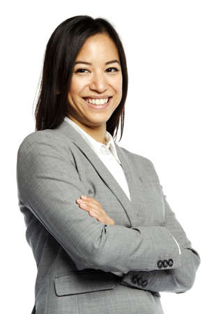 Asian business woman smiling with crossed arms against white background