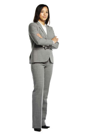 business: Asian business woman serious with crossed arms against white background