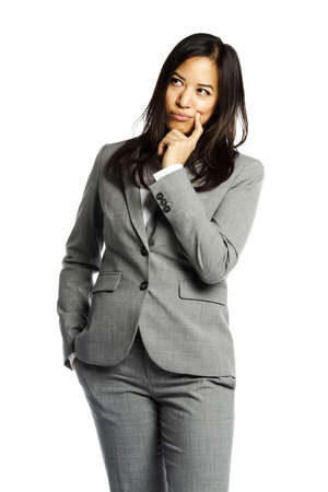 Asian business woman in pensive state looking to side photo