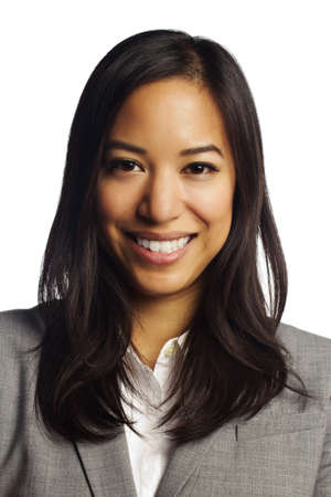Closeup of a cheerful asian business woman smiling at camera on white photo