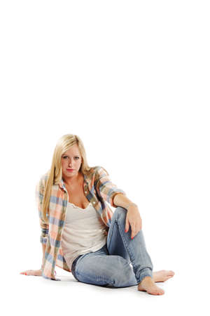 vertical composition: Full length portrait of attractive young female sitting on white background - Vertical composition