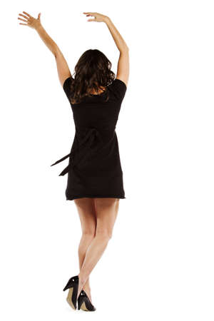 whitebackground: Rear view of a sexy young female jumping with joy over whitebackground - Vertical composition