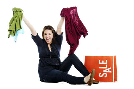 Beautiful young female holding up clothes with sale on bag Stock Photo - 12833056