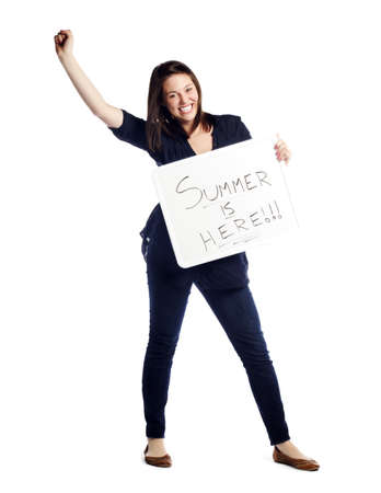 signboard: Portrait of excited young female holding summer is here sign against white background