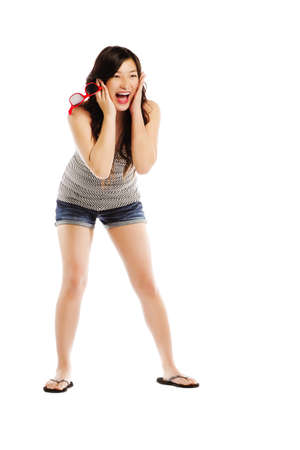 Full length portrait of young asian female screaming with joy on white - Copyspace  photo