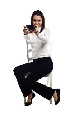 Cheerful young business woman clicking pictures on her smartphone - Vertical composition
