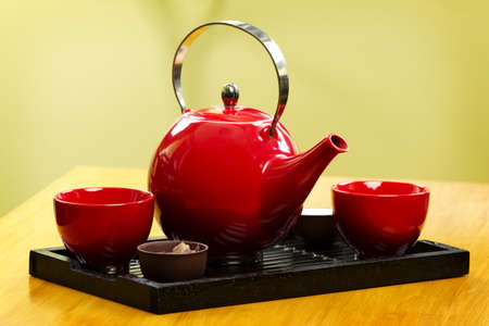 lychee and peony green tea in a red pot on wood table Stock Photo