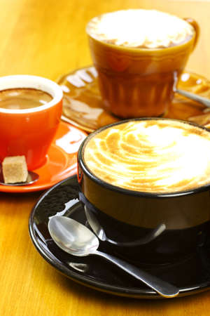 Three coffee drinks on wood table cafe latte espresso and cappucino Stock Photo - 13586421