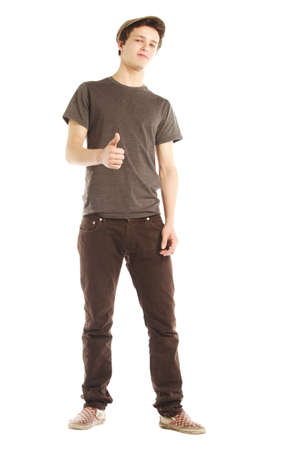 cool guy: Young man dressed in hip style with thumbs up against white background