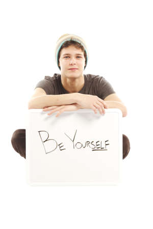 Young man with hip style holding sign that says be yourself Stock Photo