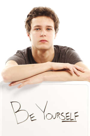 yourself: Young man with hip style holding sign that says be yourself Stock Photo