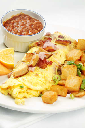 Meatlover omelet with beans and potatoes against white background Stock Photo - 13586431