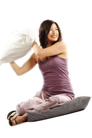 Young asian woman holding pillow ready for a fight photo