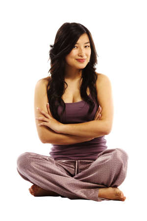 yoga pillows: Young asian woman crossed arms sitting on ground Stock Photo