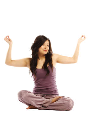 Asian woman in lotus position enjoying the moment