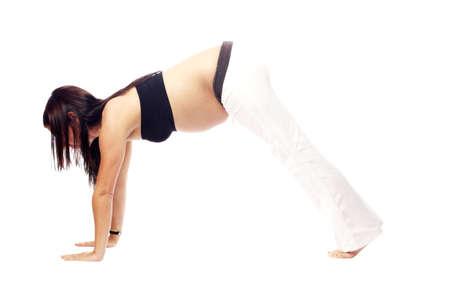 sports wear: Beautiful pregnant woman performing yoga in sports wear
