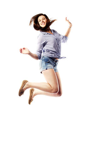 Young woman jumping in the air happily photo