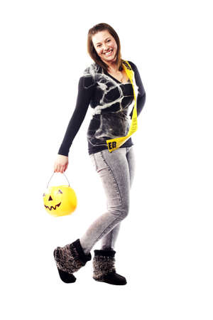 treating: Young lady dressed to go trick of treating on halloween Stock Photo