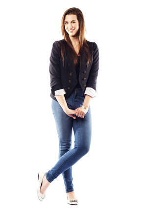 Portrait of beautiful young woman wearing blazer and crossing her legs Stock Photo - 15599386