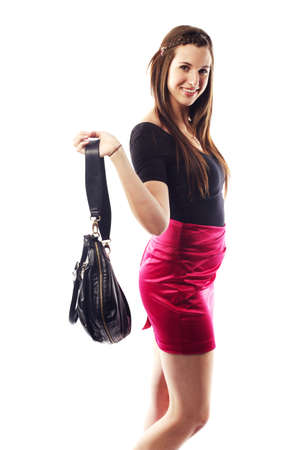 Beautiful young lady wearing fashionable clothing ready to go out Stock Photo - 15599408
