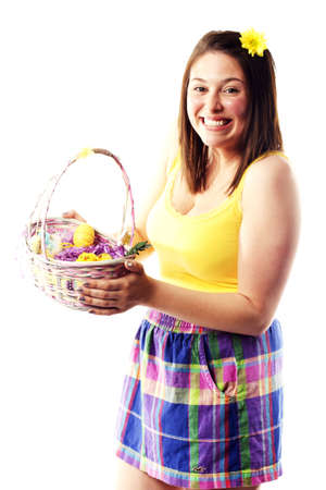 Beautiful young girl holding basket of colored eggs for easter Stock Photo - 15599449