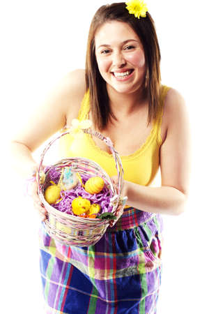 Beautiful young girl holding basket of colored eggs for easter Stock Photo - 15599502