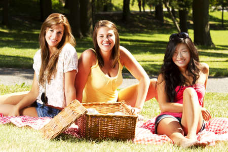 Girls having a pic nic in a park photo
