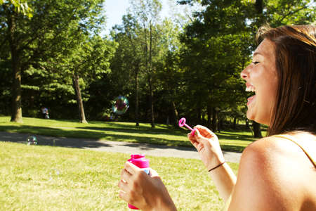 pic nic: Girl having a pic nic in a park blowing bubbles