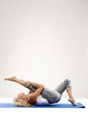 Mature woman stretching and working out.