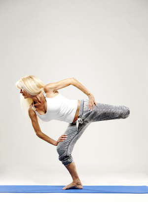 Mature woman stretching and working out. photo