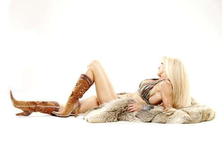 Mature woman in bikini and cowboy boots with fur Stock Photo - 15836311