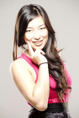 Beautiful asian woman in fancy dress smiling for camera