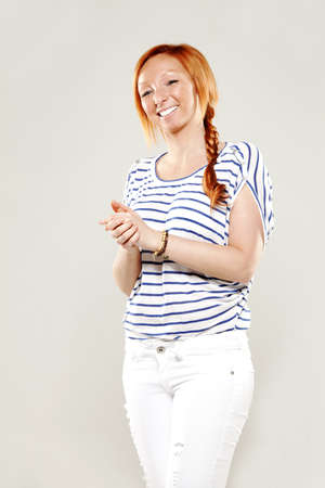 Red head woman very happy in studio photo