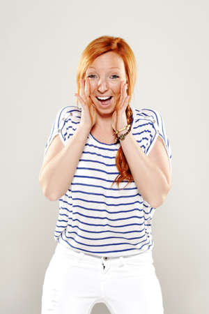red head: Red head woman very happy in studio Stock Photo
