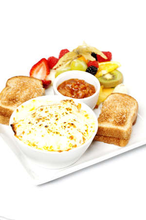Breakfast casserole dish with toast and fresh fruit photo