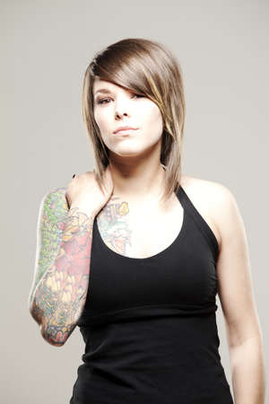 aggressive people: Beautiful girl with tattoos with an alternative style