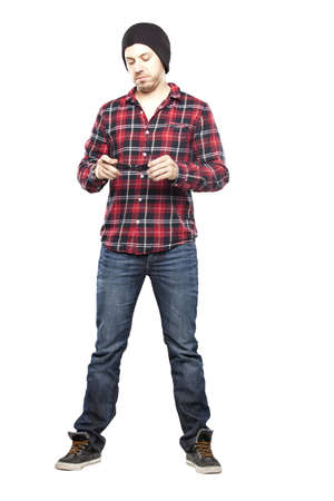 Hipster man in plaid shirt smiling for camera Stock Photo