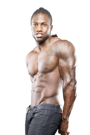no shirt: Black fitness model in jeans with no shirt flexing muscles
