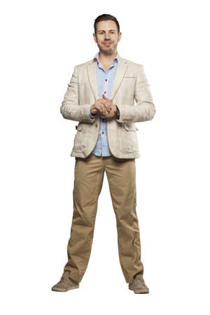 blazer: Young man in blazer looking confident against white background Stock Photo