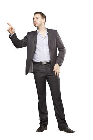 1 person: Young man in black suit against white background