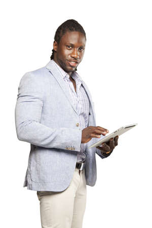haitian: Black business man in light suit using tablet computer against white background Stock Photo