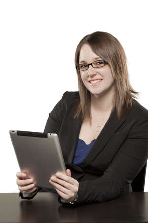 Young woman playing on Ipad with expressive face Stock Photo